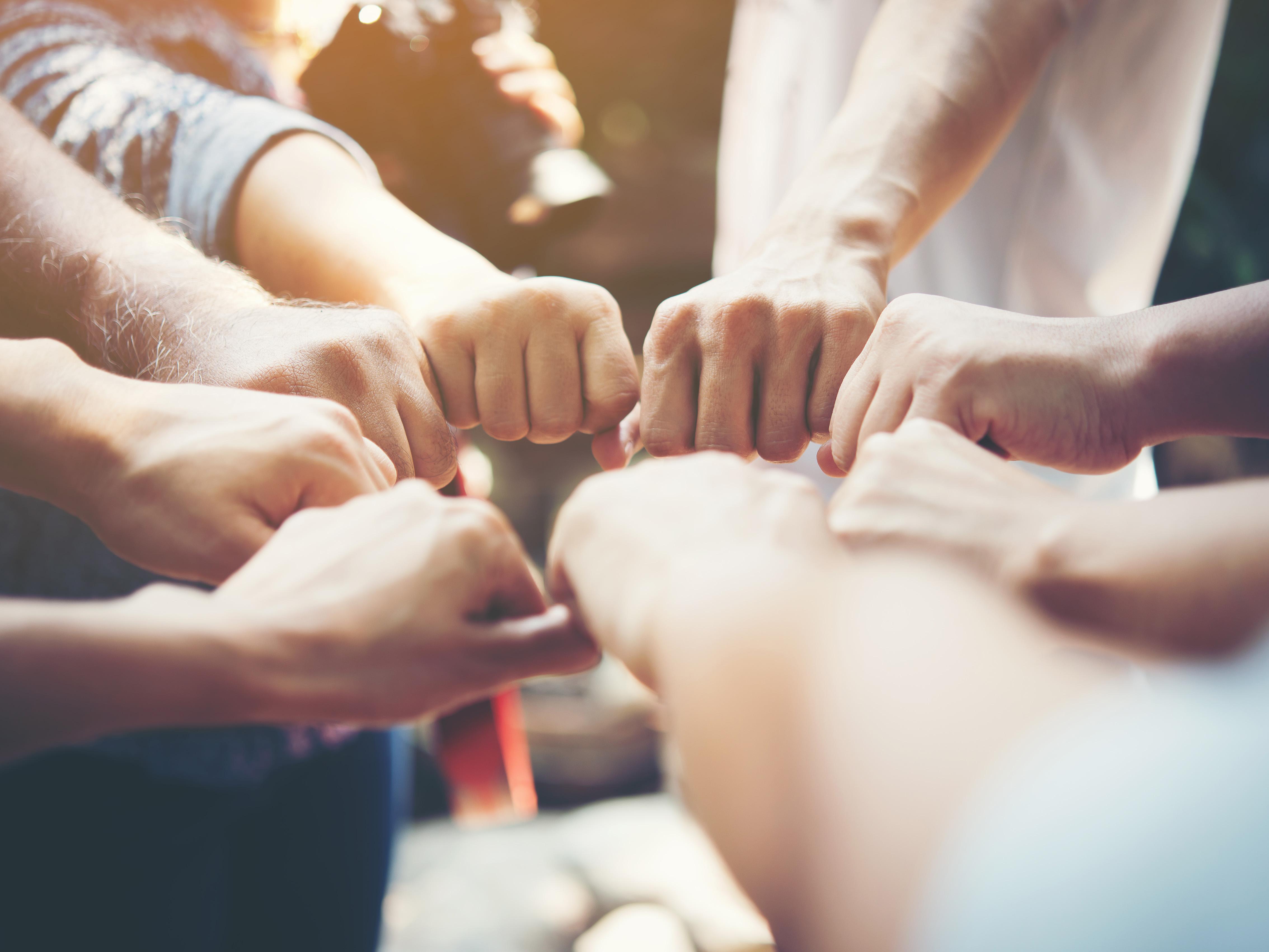 Teamsymbolik mit Händen